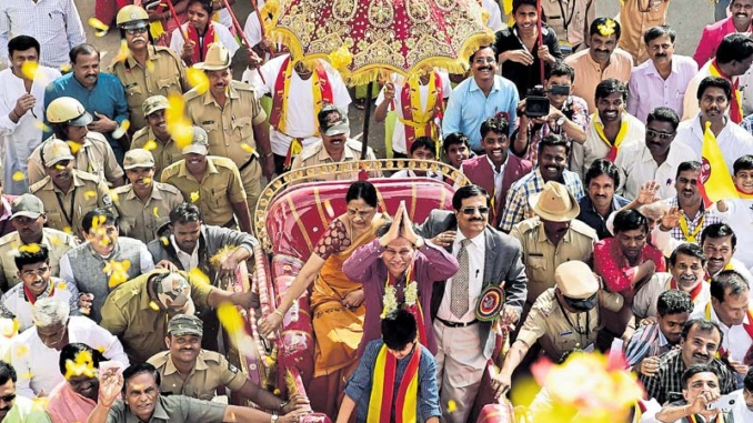 Sammelana President Baragoor Ramachndrappa is being taken in a procsion during the 82th Kannada Sahitya Sammelana in Raichur on Friday. -Photo by KRISHNAKUMAR P S